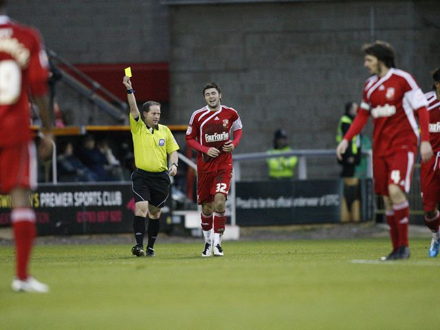 Austin receives a caution after his goal celebration - pic from swindontownfc.co.uk