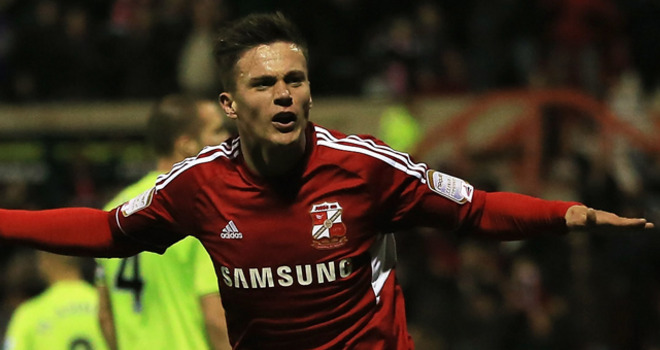Swindon striker Miles Storey scores against Aston Villa League Cup